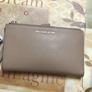 Michael Kors cellphone wallet with wrist strap